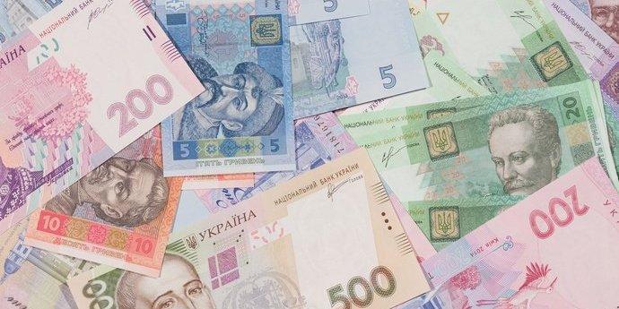 Офіційний курс гривні в Україні продовжує рекордно знижуватися