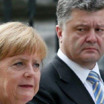 Меркель і Порошенко домовилися про посередництво експертів із Франції та Німеччини для повернення російських офіцерів до СЦКК